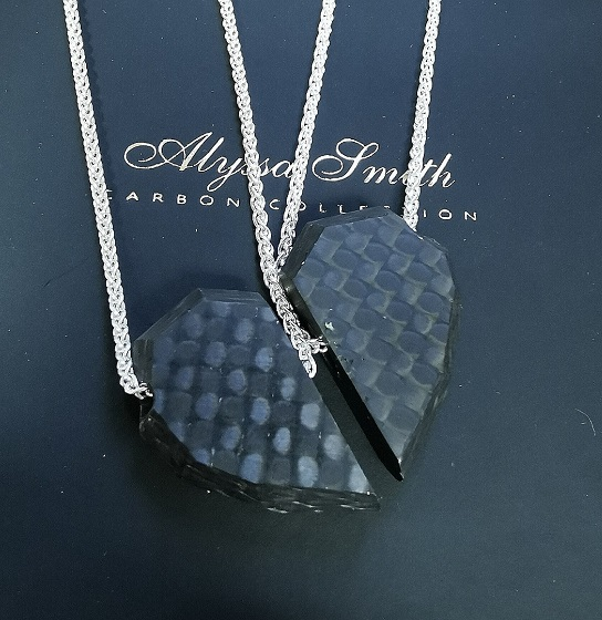 Friendship necklaces like you have never seen before. Perfect to keep one for yourself, and give the other half to your best friend or better half! This necklace set comes with two chains, and you can pick your ideal chain length for each half. They will be delivered in 2 x branded boxes too. Each half of the carbon fibre heart measure approx.. 2.2cm from top to bottom. Brilliant for you and your racing buddy, whoever that may be. When put together, they form a perfect heart- and when separated, you would not even know it was half a secret heart! Because they are hand machined, no two hearts are the same. The beauty of the carbon weave is clearly visable in each necklace- and they have been threaded onto chunky sterling silver 'spiga' style chains. Each chain link measures around 3mm in size. These friendship necklaces will be delivered in 2 x branded luxurious boxes with a certificate of authenticity.